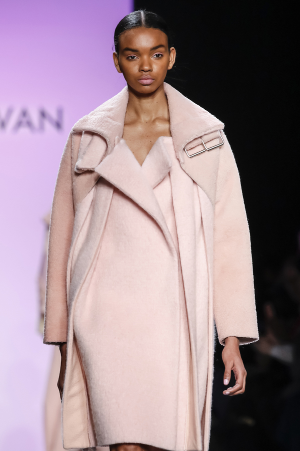 New York, NY, USA - February 13, 2016: A model walks the runway at the Son Jung Wan runway show during of Fall/Winter 2016 New York Fashion Week at The Dock, Skylight at Moynihan Station, Manhattan.